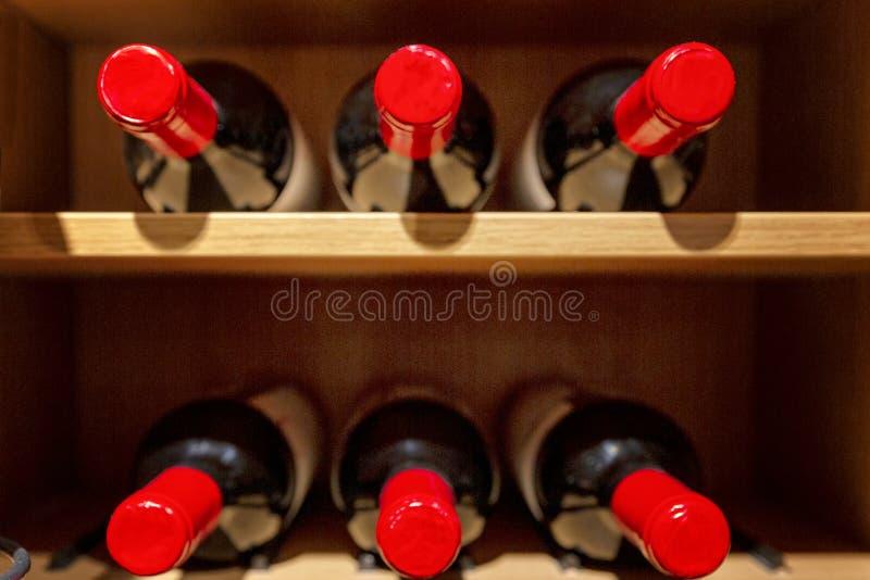 Large wine racks. Many different alcoholic beverages. Luxury enoteca. The photo is blurry. Horizontal stock image