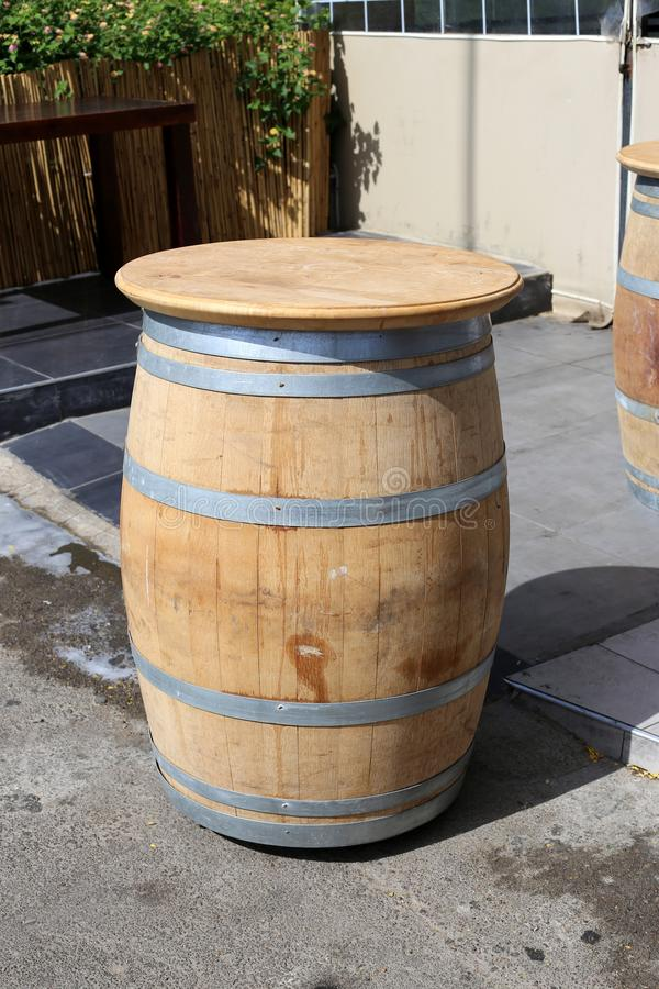 A large wooden barrel stands on a city street. In northern Israel stock photography