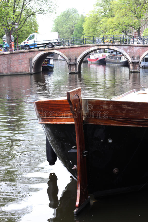 Large wooden boat in Amsterdam, Prinsengracht canal. This old wooden boat is moored in the Prinsengracht canal, in Amsterdam royalty free stock photo