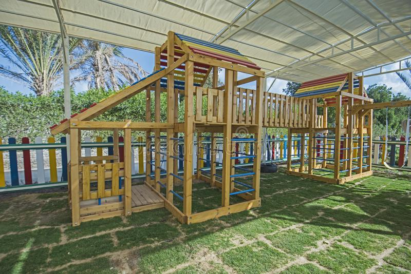 Large wooden climbing frame in children`s playground area. Large wooden climbing frame structure in children`s playground area of luxury hotel stock image