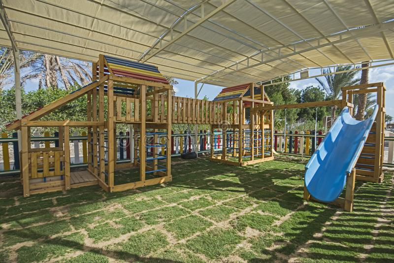 Large wooden climbing frame in children`s playground area. Large wooden climbing frame structure in children`s playground area of luxury hotel royalty free stock images