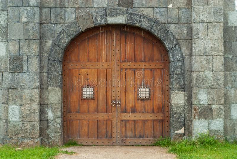 Large wooden door with carvings on a building royalty free stock images