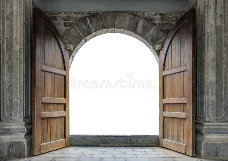Large wooden door open in castle wall stock photography