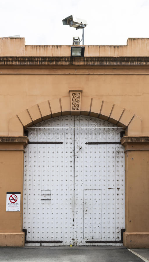 Large Wooden Gate/Door at the Adelaide Gaol, Adelaide, South Aus. Adelaide, South Australia, Australia - August 14, 2016: One of the large wooden gates viewed stock photos