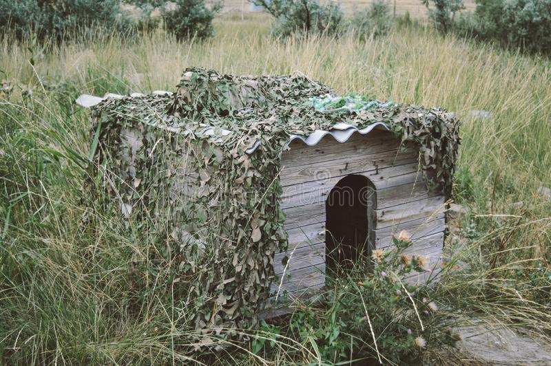 A large wooden house for the dog in the yard. House for animals stock photos
