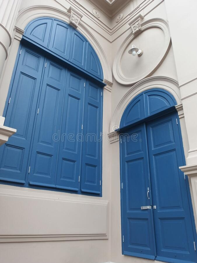 Large wooden window doors, neoclassical architecture. Images for commercial user stock photo
