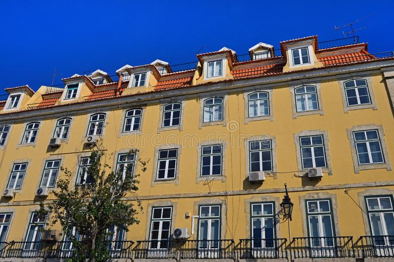 A large yellow house with balconies in Lisbon royalty free stock photos