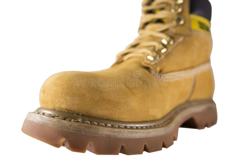 Large yellow shoes with rough soles and laces royalty free stock photography
