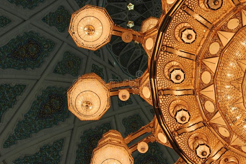 Closeup of the Main Chandelier of the Sultan Qaboos Grand Mosque. The largest chandelier in the world adorns the Sultan Qaboos Grand Mosque in Muscat, Oman. It stock photos