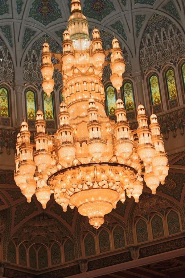 The Main Chandelier of the Sultan Qaboos Grand Mosque. The largest chandelier in the world adorns the Sultan Qaboos Grand Mosque in Muscat, Oman. It weighs 8.5 stock photography
