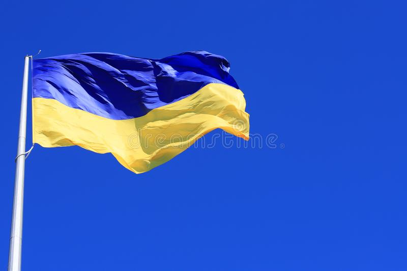The largest yellow and  blue state flag of Ukraine on the flagpole  in the  Ukrainian Dnepr city, Dnipropetrovsk, stock image
