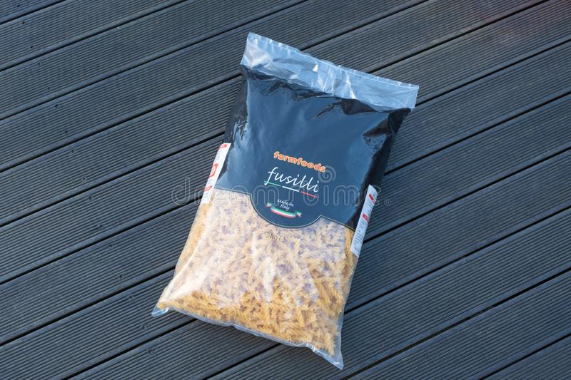 Extra large bag of Farmfoods Branded Fusilli Pasta Twists. Largs, Scotland, UK - February 04, 2019: An extra large bag of Farmfoods branded Fusilli pasta stock photos