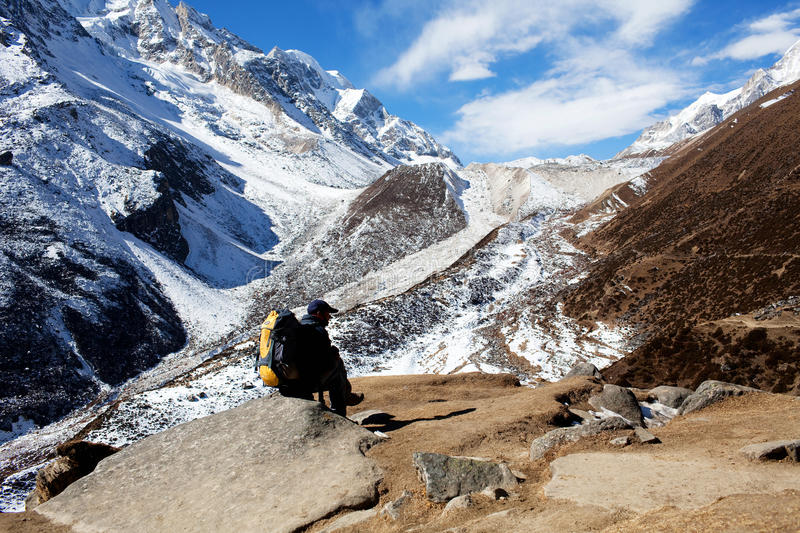 Larke pass, Nepal. Man hiker on the road to Larke Pass in the Nepal Himalaya. A glacial saddle known as Larke Pass (Larkya La), with an elevation of 5,106 metres stock image