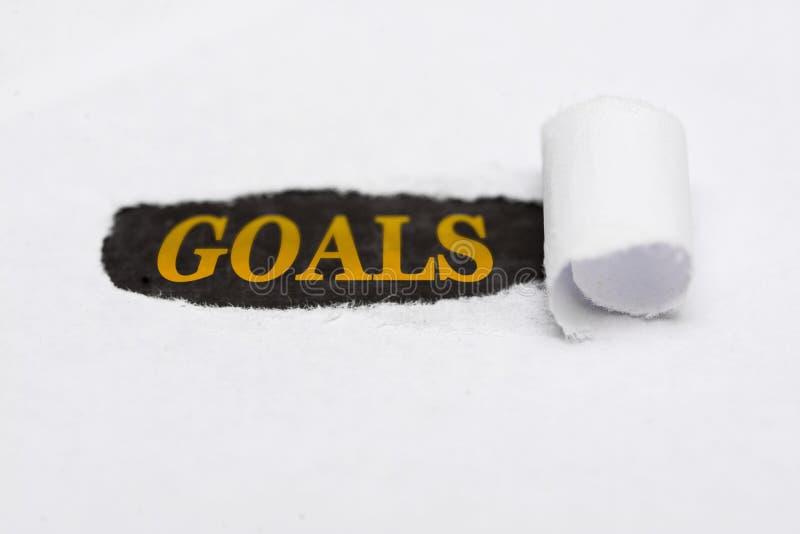 Larme de papier avec les buts de mot Les buts écrits sous la larme ont plié le papier photographie stock