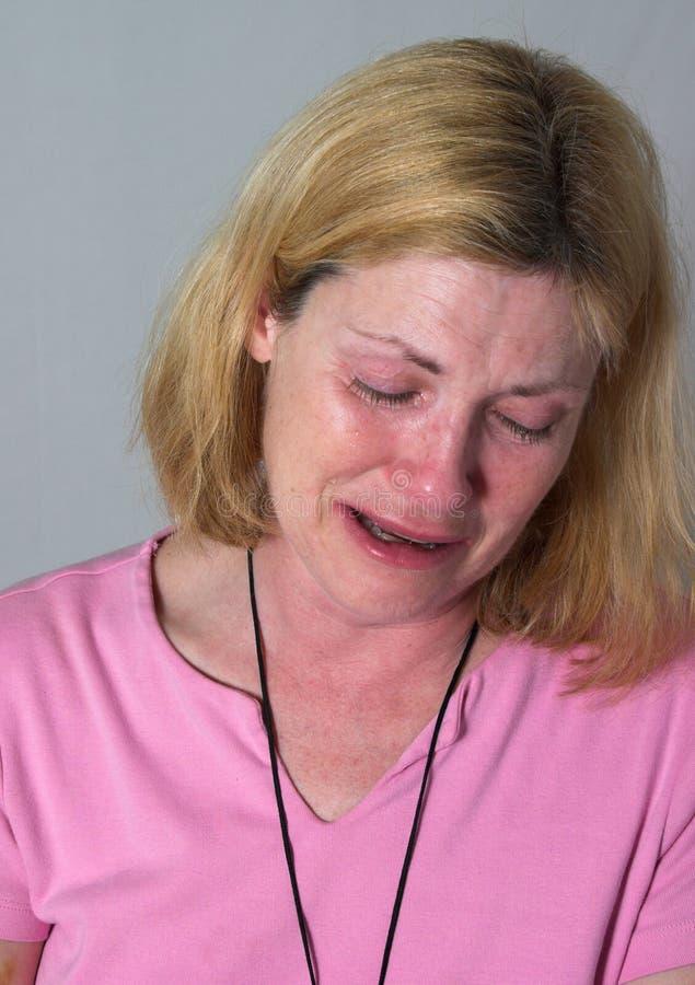 Larmes pleurantes de femme photo stock