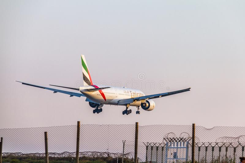 Emirates Airline Boeing 777 above the fence seconds before landing at Larnaca International Airport. Larnaca, Cyprus - April 29, 2018: Emirates Airline Boeing royalty free stock photos