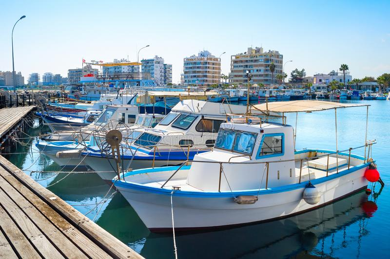 Larnaca Marina cityscape, yachts, boats. Marina with white moored yachts and motorboats, Larnaca cityscape in background, Cyprus royalty free stock images