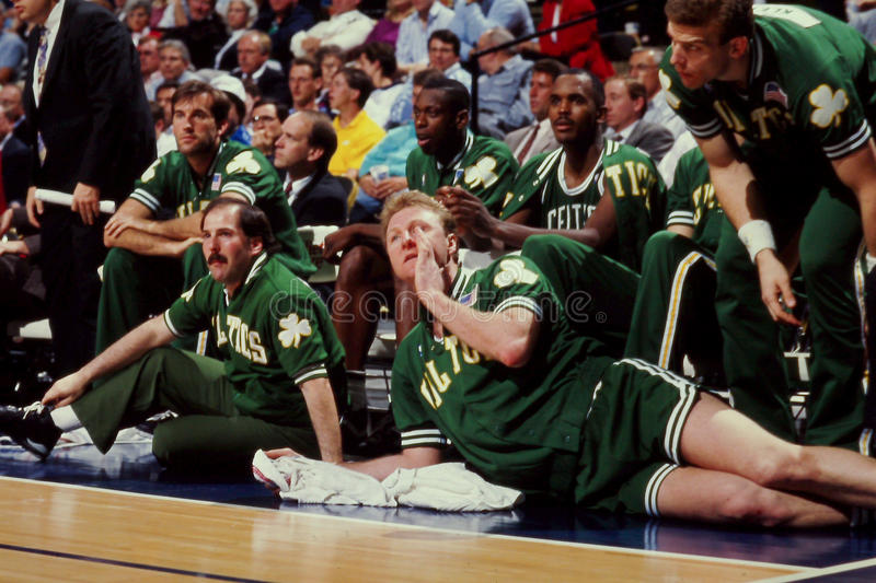 Larry Bird, Boston Celtics. Larry Bird rests his ailing back. (Image from a color slide royalty free stock photo