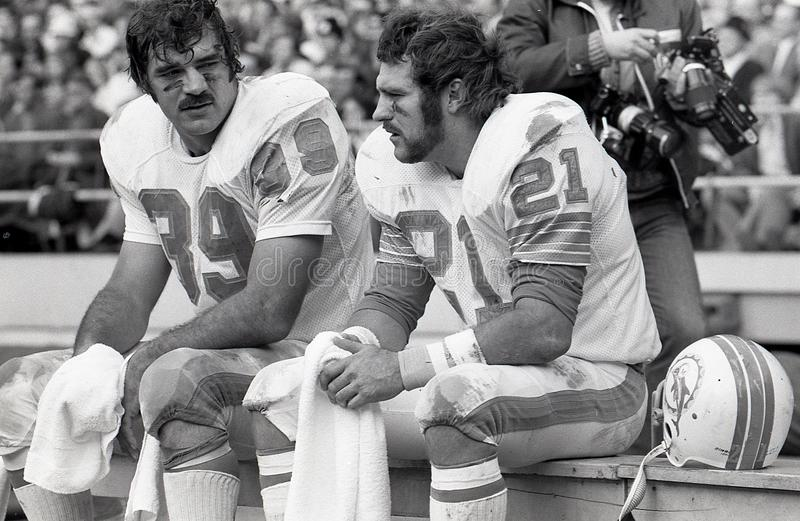 Larry Csonka and Jim Kiick, Miami Dolphins. Former Miami Dolphins stars Larry Csonka and Jim Kiick, sitting on the bench. Image taken from b&w negative royalty free stock image