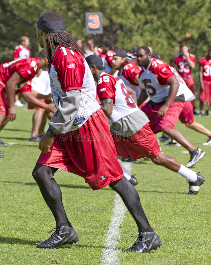 Larry Fitzgerald at Cardinals training camp. The Arizona Cardinals star wide receiver, Larry Fitzgerald, practices at training camp after signing a multi-million royalty free stock images