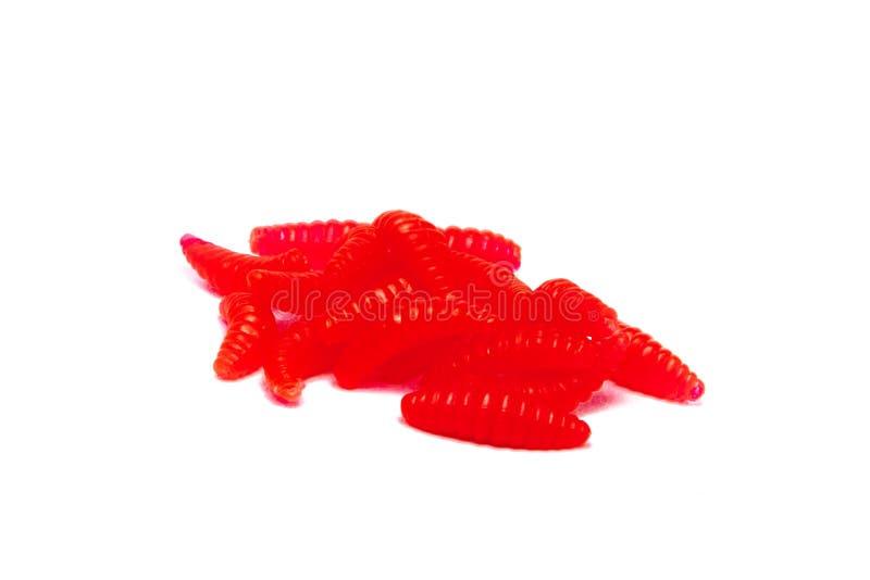 Larvas pesqueras artificiales rojas de insectos en el fondo blanco con la sombra suave fotos de archivo libres de regalías