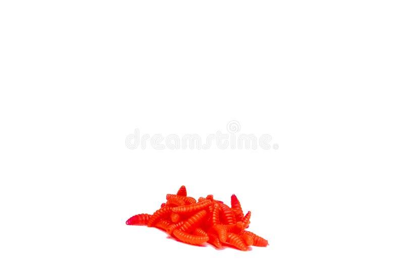 Larve da pesca artificiali rosse degli insetti su fondo bianco con ombra molle immagini stock libere da diritti