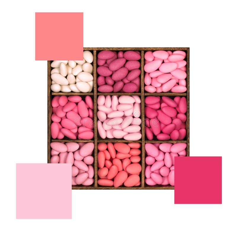 Las almendras azucaradas rosadas colorean esquema con muestras foto de archivo libre de regalías