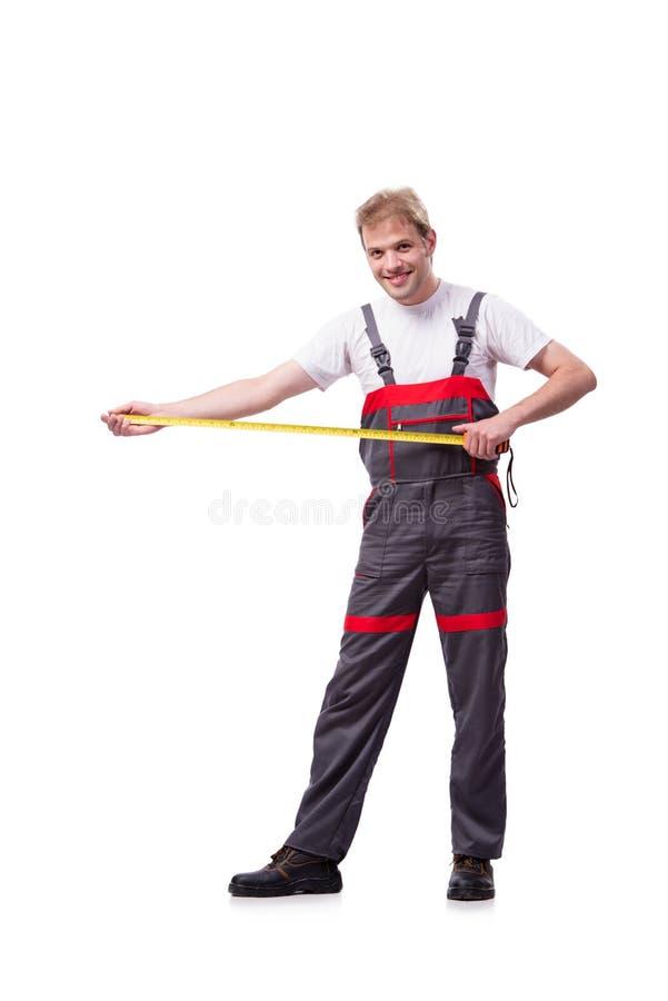 Las batas que llevan jovenes del trabajador de construcción aisladas en blanco fotografía de archivo libre de regalías