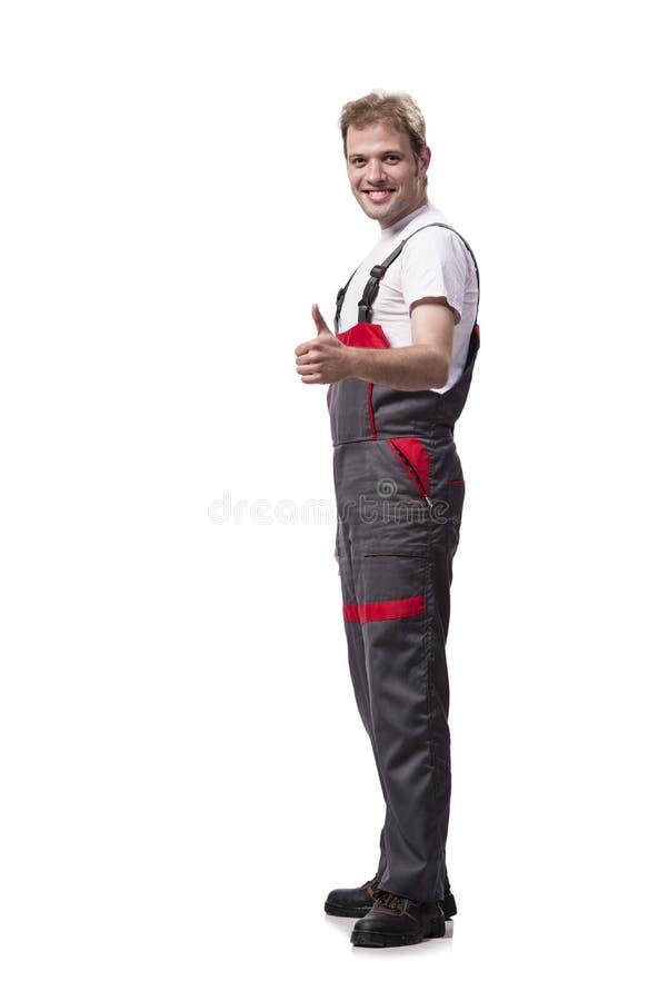 Las batas que llevan jovenes del trabajador de construcción aisladas en blanco imagenes de archivo