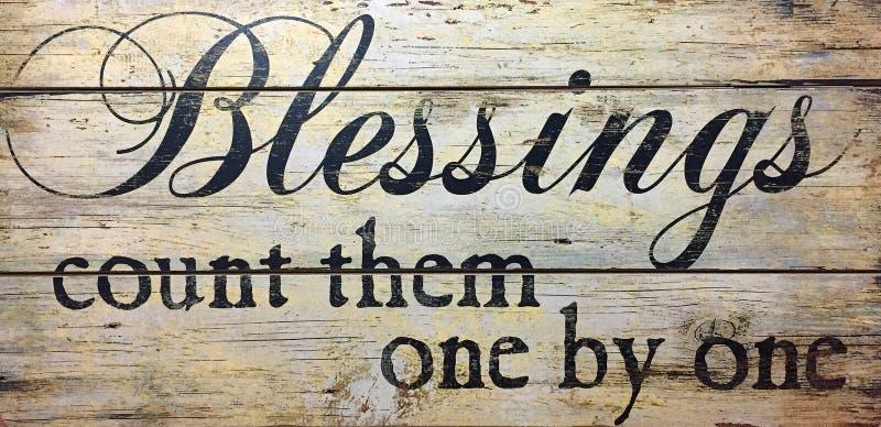 Las bendiciones los cuentan uno por uno imagen de archivo