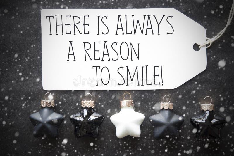 Las bolas negras de la Navidad, copos de nieve, citan siempre razón para sonreír imagenes de archivo