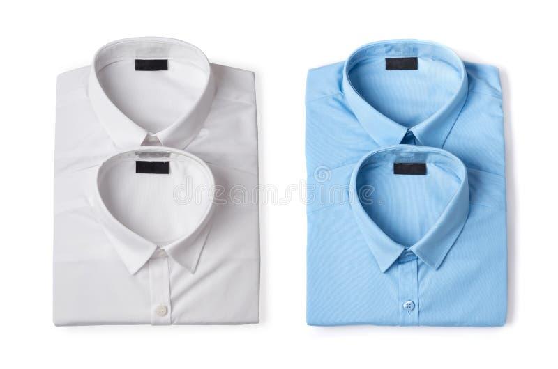 Las camisas de los nuevos hombres azules y blancos fotos de archivo