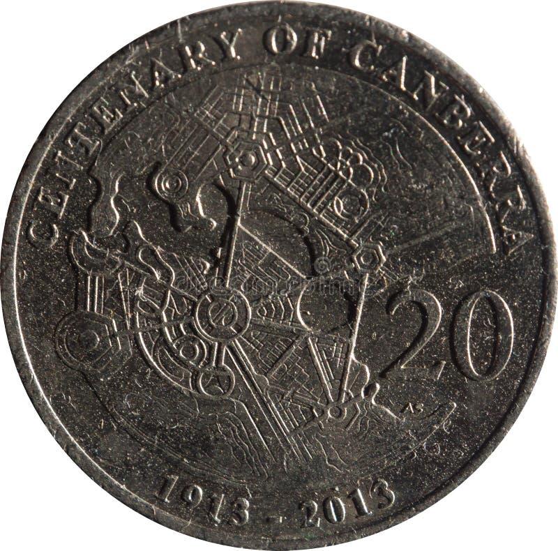 Las características australianas de la moneda del veinte-centavo que conmemoran el centenario de Canberra, aislado en el fondo bl fotos de archivo libres de regalías