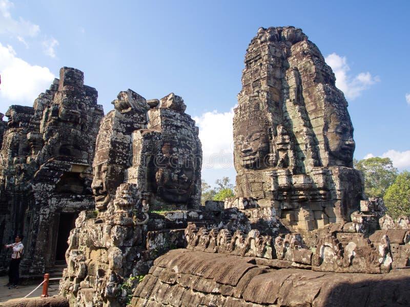 Las caras del templo de Bayon en el Angkor Wat en costura cosechan la ciudad, Camboya en 2012, el 9 de diciembre imagen de archivo libre de regalías