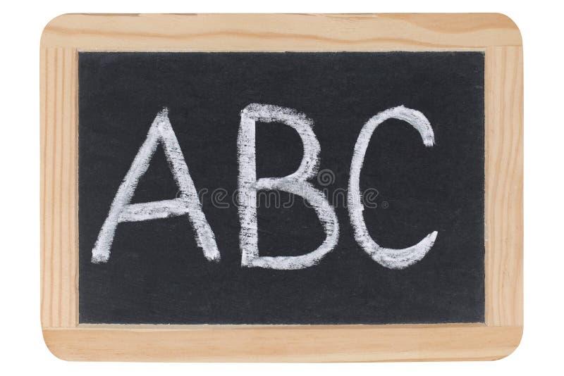 Las cartas ABC en una pizarra en la escuela fotografía de archivo