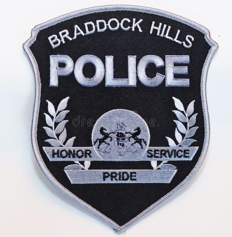 Las COLINAS negras y de plata sometidas de BRADDOCK LIMPIAN el remiendo de hombro en un fondo blanco fotografía de archivo libre de regalías