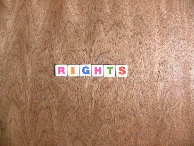 Las derechas de la palabra en el fondo de madera foto de archivo