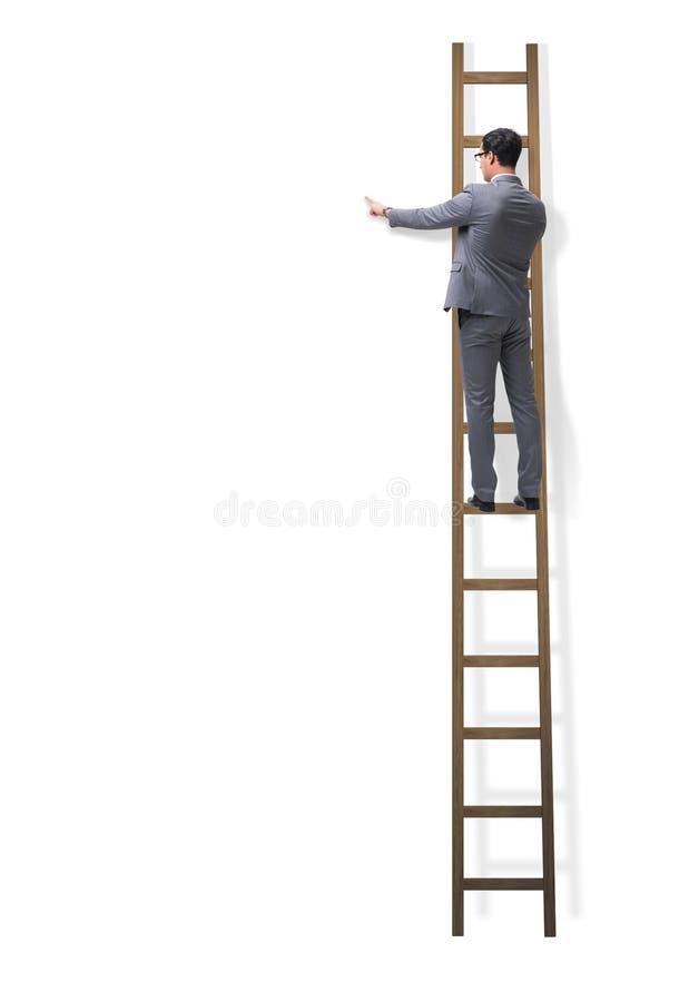 Las escaleras que suben del hombre de negocios aisladas en blanco fotos de archivo libres de regalías