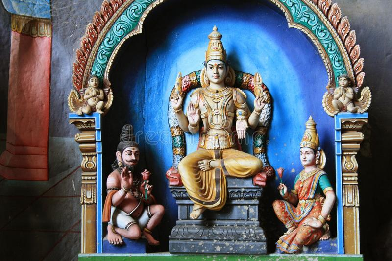 Las estatuas tradicionales de dios hindú en Batu excavan, Kuala Lumpur, Malasia imagenes de archivo