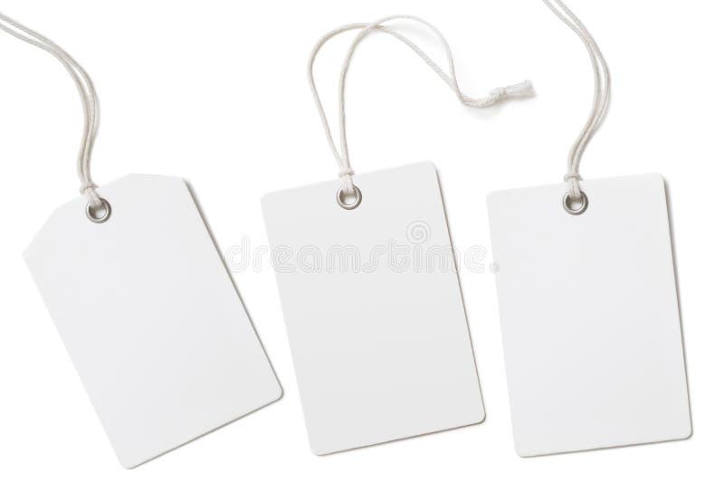 Las etiquetas o los precios del paño del papel en blanco fijaron aislado imagen de archivo