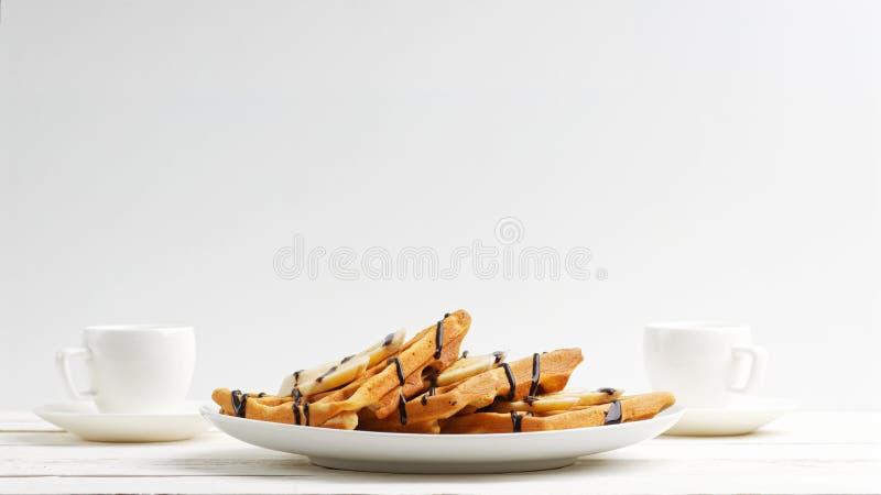 Las galletas belgas hechas en casa con las rebanadas del pl?tano remataron foto de archivo