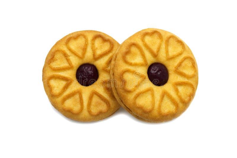 Las galletas del bocadillo llenaron de un atasco y de un dulce del arándano condimentadas imágenes de archivo libres de regalías