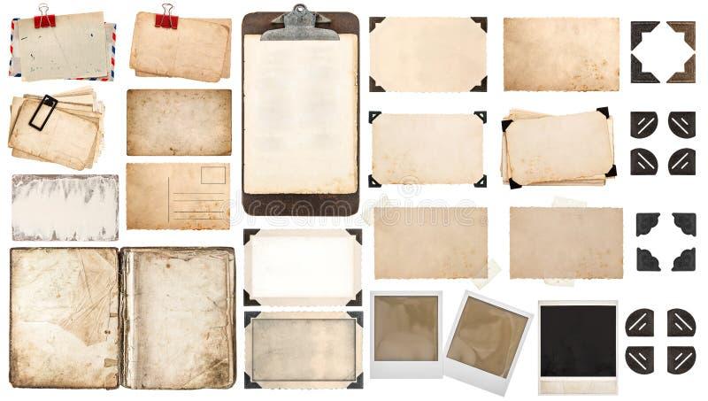 Las hojas de papel, libro, foto vieja enmarcan las esquinas, tablero imagen de archivo libre de regalías