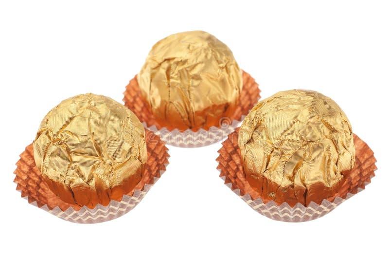 Las ideas del regalo envolvieron los caramelos de chocolate. fotos de archivo libres de regalías