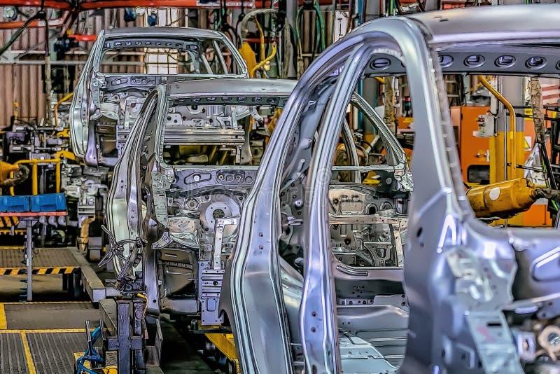 Las líneas de producción automotriz revolucionaron la industria automotriz Hicieron los autos más eficientes imágenes de archivo libres de regalías