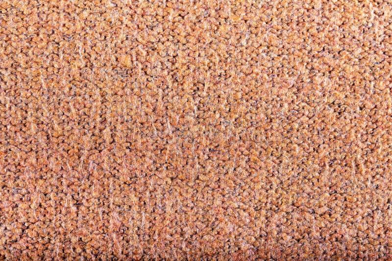 Las lanas anaranjadas hacen punto la textura, fondo fotografía de archivo libre de regalías