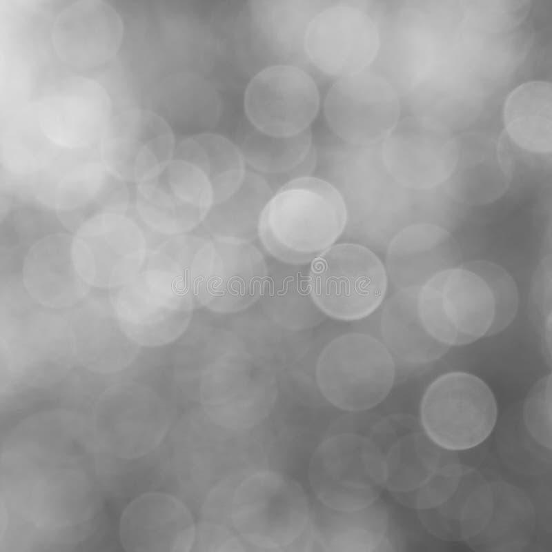 Las luces chispean en un fondo gris fotografía de archivo