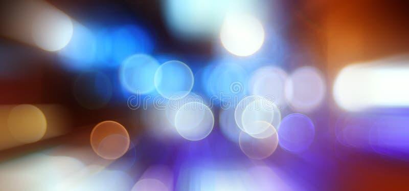 Las luces de la ciudad de Bokeh empañaron el fondo imagenes de archivo