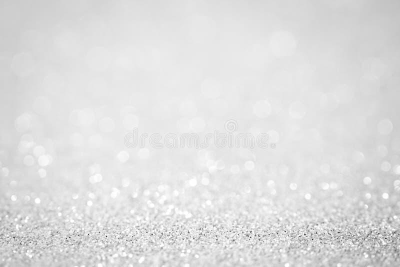 Las luces en centelleo hermoso del extracto de plata blanco del fondo se encienden imágenes de archivo libres de regalías