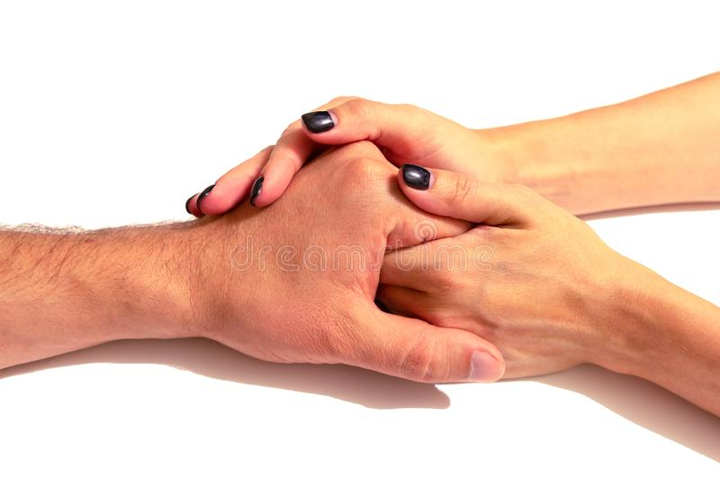 Las manos de la esposa llevan a cabo suavemente la mano de su marido isola imagen de archivo libre de regalías